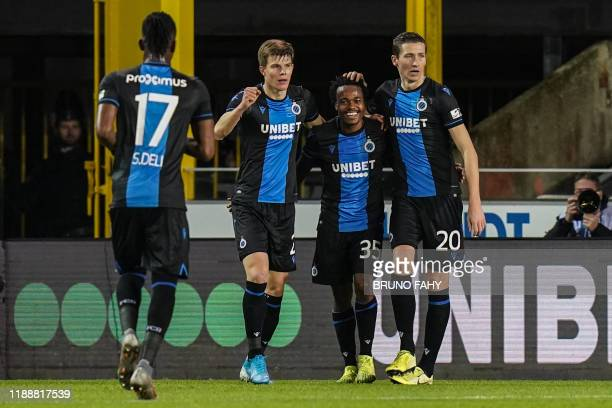 Club's Percy Tau celebrates with his teammates after scoring during a soccer match between Club Brugge and KV Mechelen, Sunday 15 December 2019 in...