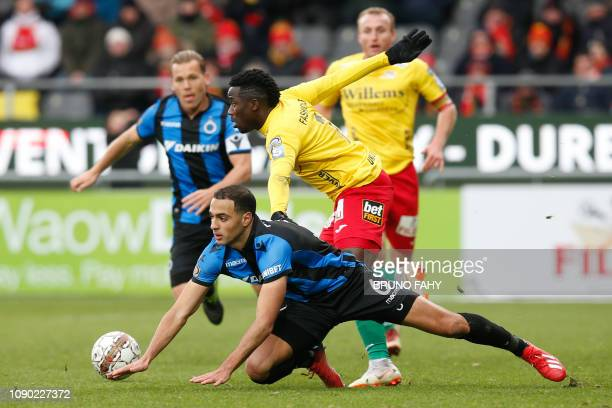 Club's Sofyan Amrabat and Oostende's Fashion Junior Sakala fight for the ball during the soccer match between KV Oostende and Club Brugge Sunday 27...