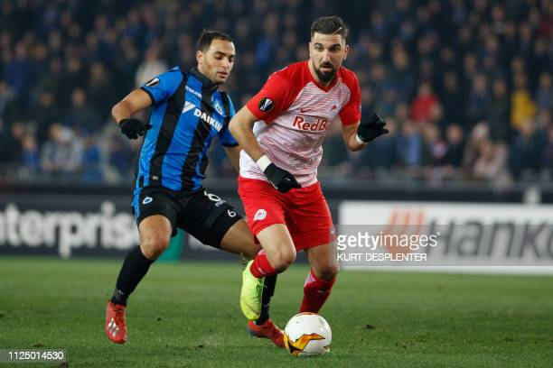 Club's Sofyan Amrabat and Salzburg's Moanes Dabour fight for the ball during a soccer game between Belgian team Club Brugge KV and Austrian club FC...