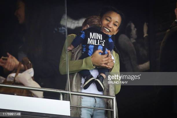 Club's Thomas Meunier's girlfriend Deborah Panzokou and their son Landrys celebrate after the Jupiler Pro League match between Club Brugge and...