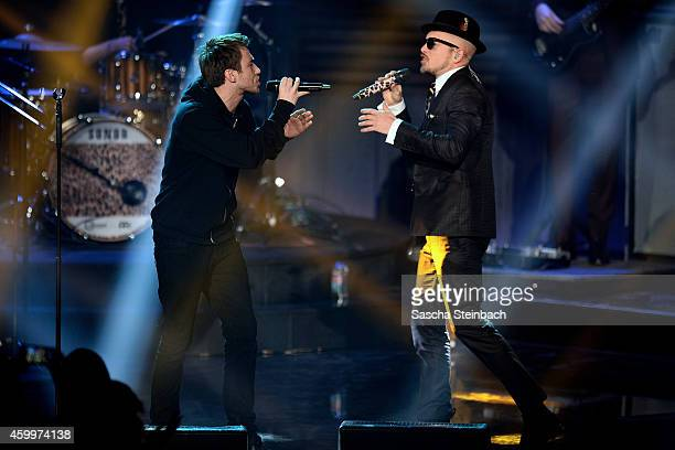 Clueso and Jan Delay perform during the 1Live Krone 2014 at Jahrhunderthalle on December 4 2014 in Bochum Germany