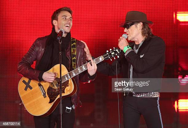 Clueso and Udo Lindenberg performs at the Brandenburg Gate during celebrations on the 25th anniversary of the fall of the Berlin Wall on November 9...