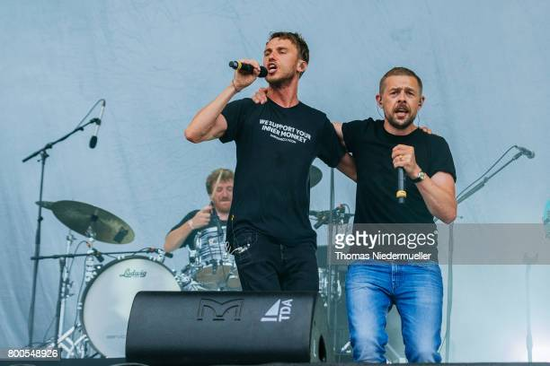 Clueso performs with TV host Klaas HeuferUmlauf during the second day of the Southside festival on June 24 2017 in Neuhausen Germany
