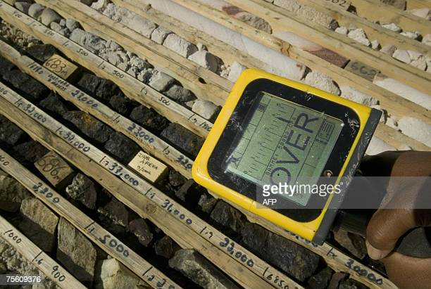 An employee at Areva Resources Canada's Shea Creek exploration drilling site measures gamma counts per second emitted by the core samples using a SPP...