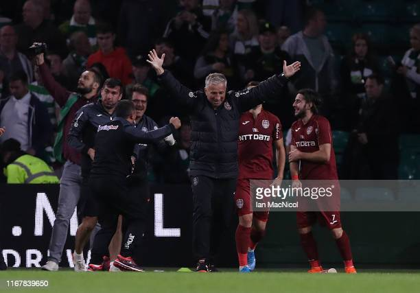 Cluj manager Dan Petrescu celebrates at full time during the UEFA Champions League, third qualifying round, second leg match between Celtic and CFR...
