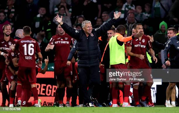 Cluj manager Dan Petrescu celebrates victory after the final whistle during the UEFA Champions League third qualifying round second leg match at...
