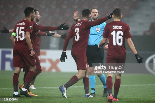 Cluj players Mario Camora, Adrian Paun, Andrei Burca and Mateo Susic protesting in front of referee Harald Lechner during the UEFA Europa League...