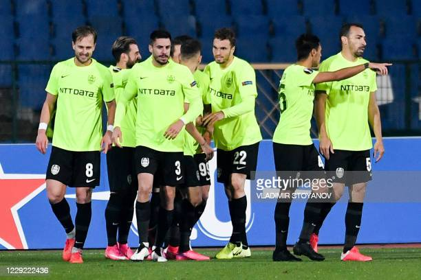 Cluj's players celebrate after scoring a goal during the UEFA Europa League Group A first-leg football match between CSKA Sofia and CFR Cluj at the...