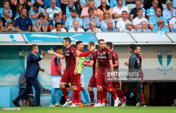 Cluj's players celebrate after scoring the opening goal during the UEFA Champions League second round, second leg qualifying football match between...