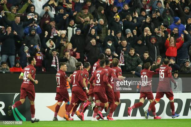 Clujs players celebrating a scored goal during the UEFA Europa League round of 32 first leg match between CFR Cluj and Sevilla FC at...