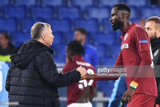 CFR Cluj's Romanian head coach Dan Petrescu congratulates CFR Cluj's Ivorian forward Lacina Traore at the end of the UEFA Europa League Group E...