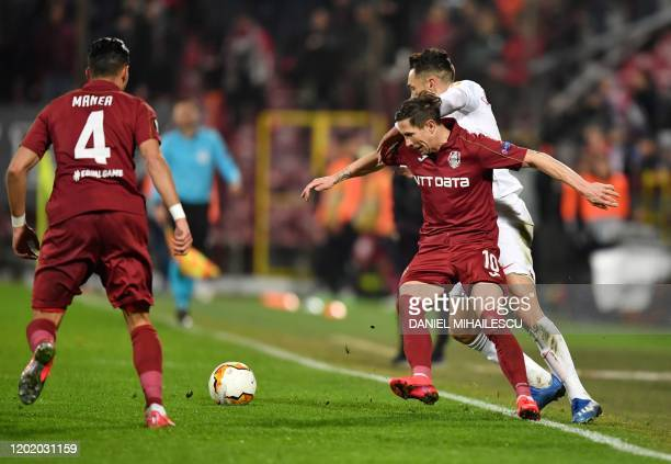 Cluj's Romanian midfielder Ciprian Deac and Sevilla's Argentinian midfielder Lucas Ocampos vie for the ball during the Europa League last 32 first...