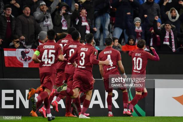 Cluj's Romanian midfielder Ciprian Deac celebrates after scoring during the Europa League last 32 first leg football match between CFR Cluj and...