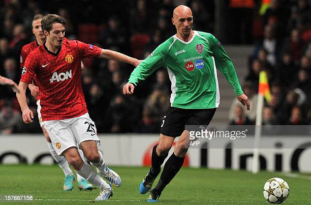 Cluj's Romanian midfielder Gabriel Muresan vies with Manchester United's English midfielder Nick Powell during the UEFA Champions League group H...