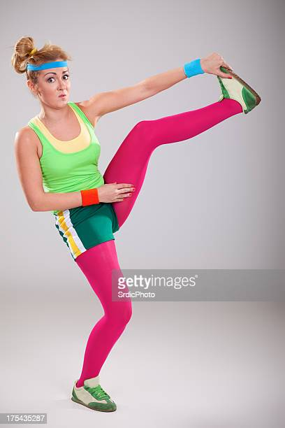 Clumsy blonde nerdy girl doing stretching exercises