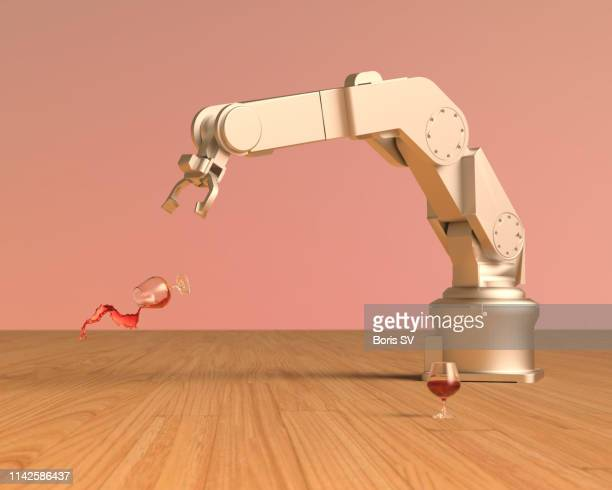 clumsy robot - robot arm stock pictures, royalty-free photos & images