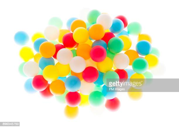 cluster of multi colored balls - sports ball stock pictures, royalty-free photos & images