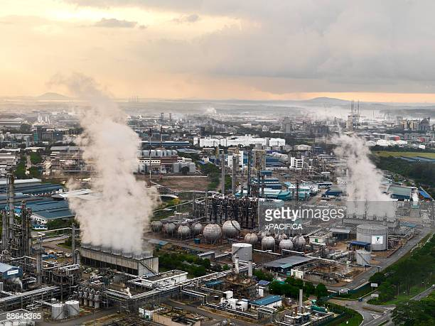 A cluster of power plants spewing out steam