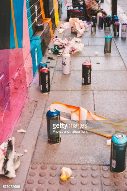 Cluster of spray paint cans, graffiti front