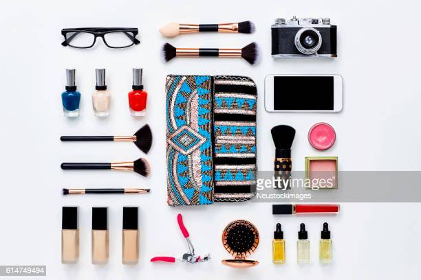 clutch bag surrounded with beauty products and technologies - knolling concept stock pictures, royalty-free photos & images