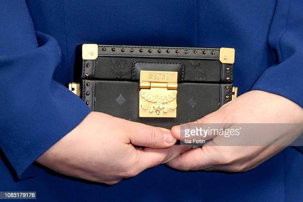 Clutch of German singer Alina Wichmann alias Alina as a detail during she arrives at the William Fan Defile during 'Der Berliner Salon' Autumn/Winter...