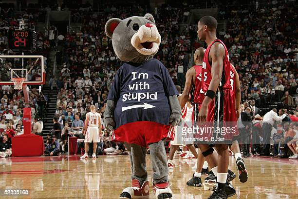 Clutch the Bear the Houston Rockets mascot plays a joke on Keyon Dooling of the Miami Heat during the game on March 24 2005 at the Toyota Center in...