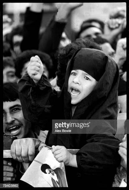 Clutching a picture of the Iranian spiritual leader the Ayatollah Khomeini a girl screams 'Death to the Great Satan Carter Death to the USA' Teheran...