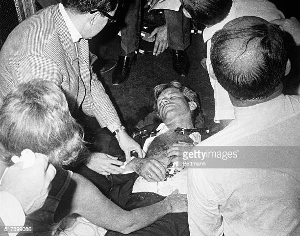 Clutching his rosary beads Senator Robert F Kennedy lies wounded on the floor of the Ambassador Hotel after being shot by an assailant following his...