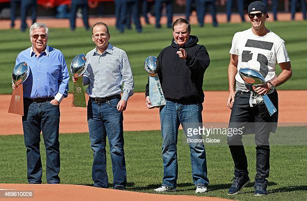 Clutching the franchise's four Vince Lombardi Trophies New England Patriots owners Robert Kraft Jonathan Kraft head coach Bill Belichick and...