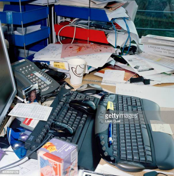 Clutter and office debris at the desk of an employee Leeds UK From the series 'Desk Job' a project which explores globalisation through office life...