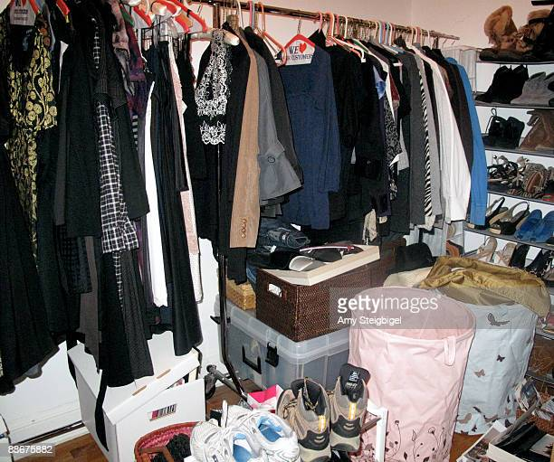 cluttered closet - walk in closet stock photos and pictures