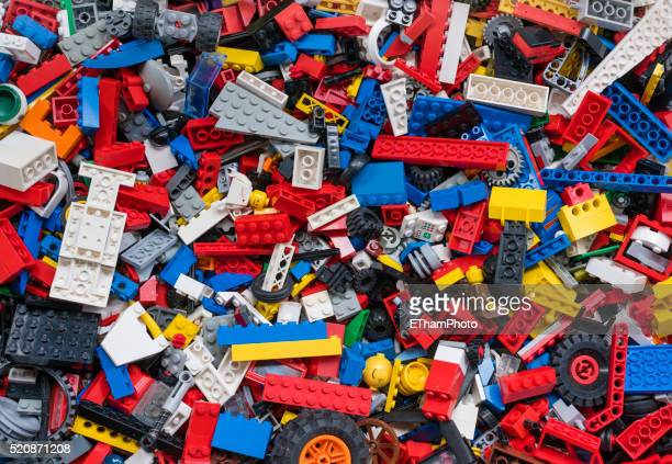 cluttered pile of many colourful lego bricks - lego stock pictures, royalty-free photos & images