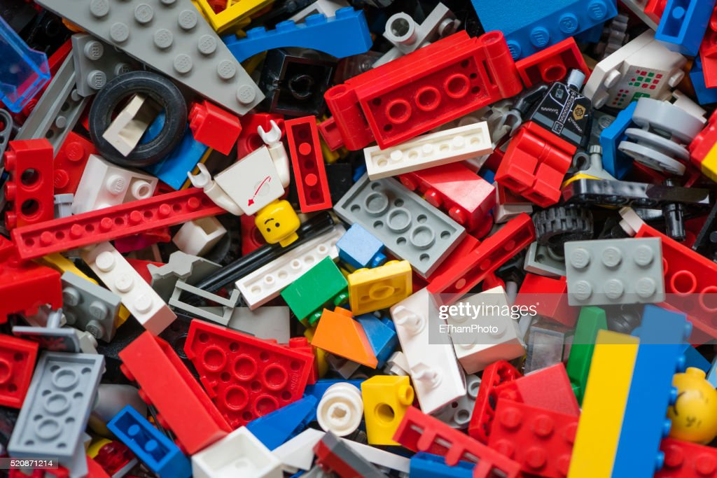 Cluttered pile of many colourful Lego bricks : ストックフォト