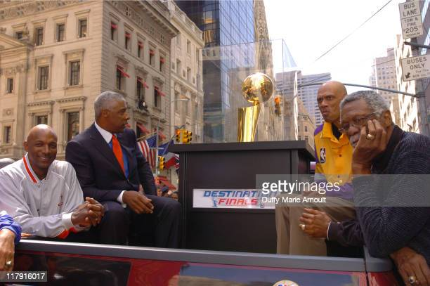 Clyde Drexler Julius Erving Kareem AbdulJabar and Bill Russel with the 2005 Larry O'Brien NBA Championship Trophy