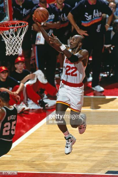 Clyde Drexler of the Houston Rockets goes for a layup against the San Antonio Spurs during the NBA game in Houston Texas NOTE TO USER User expressly...