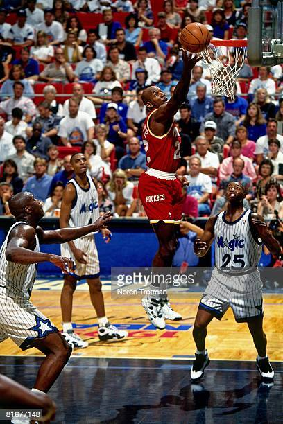 Clyde Drexler of the Houston Rockets shoots a layup in Game Two of the 1995 NBA Finals against the Orlando Magic at the Amway Arena on June 9 1994 in...