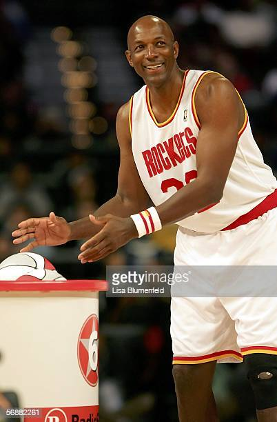 Clyde Drexler of the Houston team smiles as he reaches for a ball in the Radio Shack Shooting Stars competition during NBA AllStar Weekend at the...