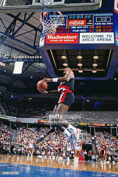 Clyde Drexler of the Portland Trail Blazers dunks against the Sacramento Kings circa 1990 at Arco Arena in Sacramento California NOTE TO USER User...