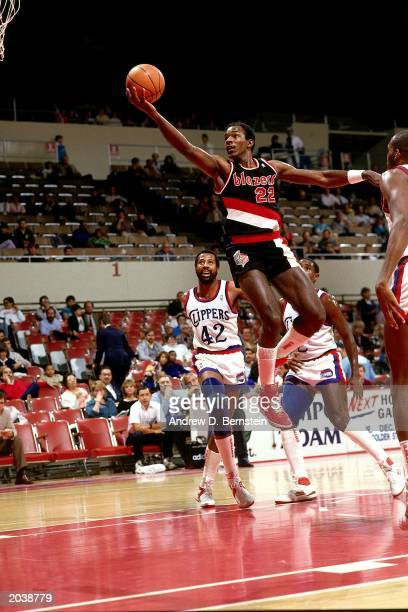 Clyde Drexler of the Portland Trail Blazers goes in for a layup in the 1986 season NBA game against the Los Angeles Clippers at the Los Angeles...