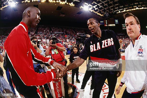 Clyde Drexler of the Portland Trail Blazers shakes hands with Michael Jordan of the Chicago Bulls prior to playing game 3 of the1992 NBA Finals at...