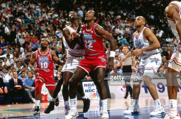 Clyde Drexler of the Western Conference All Stars battles for position against Dominique Wilkins of the Eastern Conference All Stars during the 1991...
