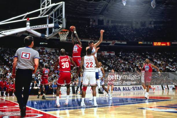 Clyde Drexler of the Western Conference AllStars dunks against the Eastern Conference AllStars during the 1991 NBA AllStar game on February 10 1991...