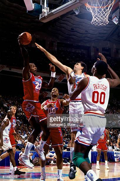 Clyde Drexler of the Western Conference AllStars passes against Kevin McHale of the Eastern Conference AllStars during the 1991 NBA All Star Game on...