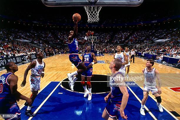 Clyde Drexler of the Western Conference AllStars shoots against Michael Jordan of the Eastern Conference AllStars during the 1992 NBA All Star Game...