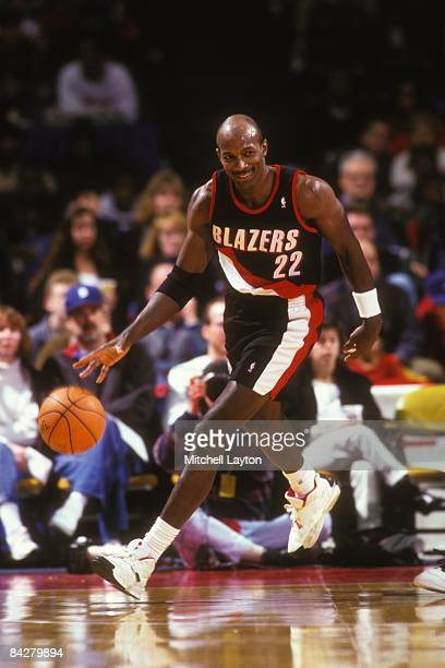 Clyde Drexler#22 of the Portland Trailblazers dribbles up court during a NBA basketball game against the Washington Bullets on January 7 1995 at...