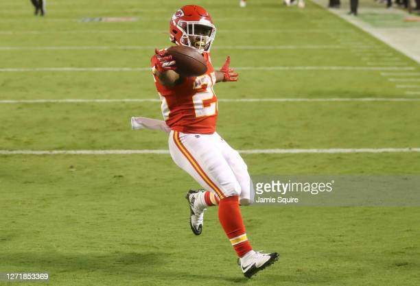 Clyde Edwards-Helaire of the Kansas City Chiefs scores a touchdown against the Houston Texans during the third quarter at Arrowhead Stadium on...