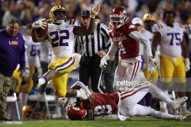 Clyde EdwardsHelaire of the LSU Tigers avoids a tackle by Jarques McClellion of the Arkansas Razorbacks to score a touchdown at Tiger Stadium on...