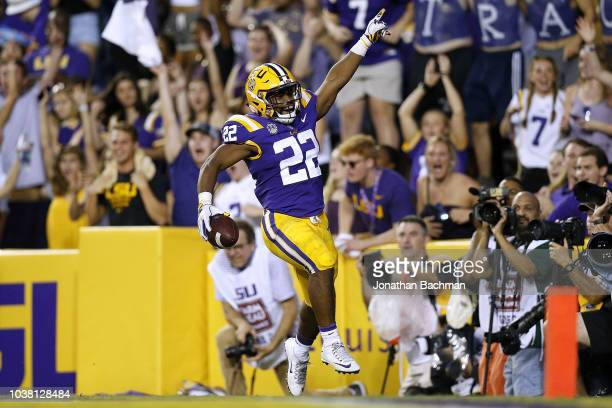 Clyde EdwardsHelaire of the LSU Tigers celebrates a touchdown during the first half against the Louisiana Tech Bulldogs at Tiger Stadium on September...