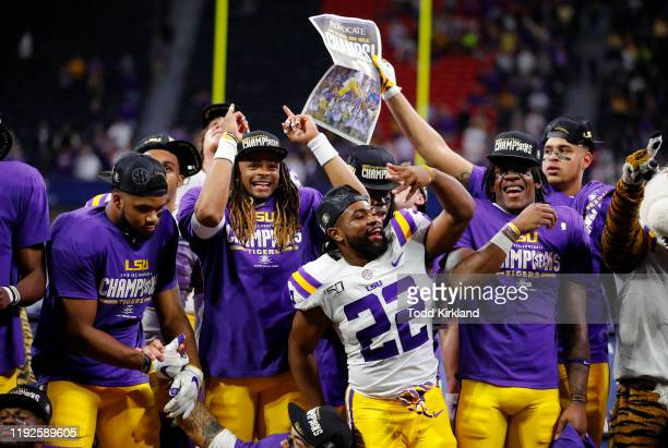 Clyde EdwardsHelaire of the LSU Tigers celebrates after defeating the Georgia Bulldogs 3710 to win the SEC Championship game at MercedesBenz Stadium...