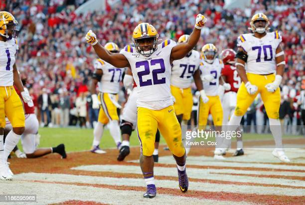Clyde EdwardsHelaire of the LSU Tigers celebrates after rushing for a 1yard touchdown during the second quarter against the Alabama Crimson Tide in...